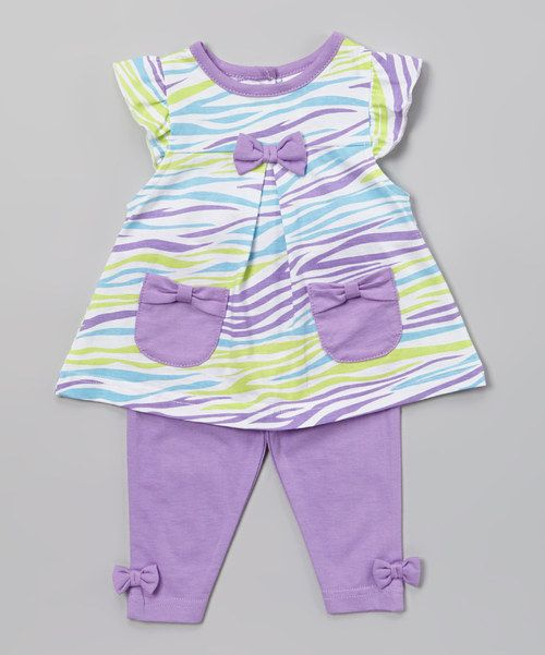 Little ladies look almost too precious in this all-cotton instant outfit. With a unique design and decorative pockets on the tunic and elastic hem on the pants, this ensemble is the epitome of infant apparel adorableness.