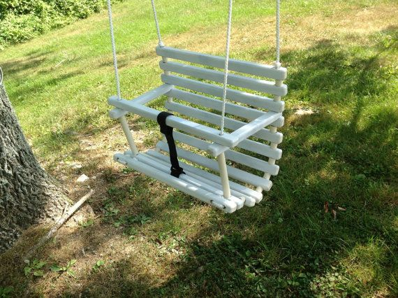 Handcrafted in Kentucky from poplar this wooden childs swing is 15 wide x 11 deep and 16 tall. This is a variation of our clear finished swing