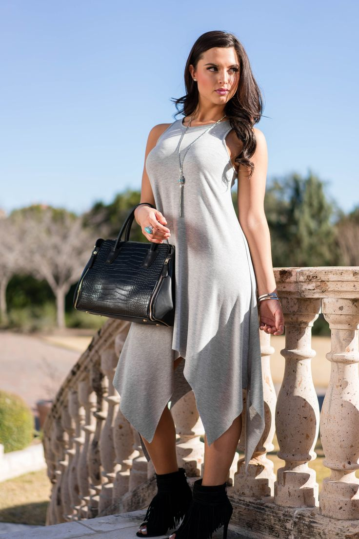Uneven, long hem and peep toe fringe heels - the right way to transition into spring fashion for women!