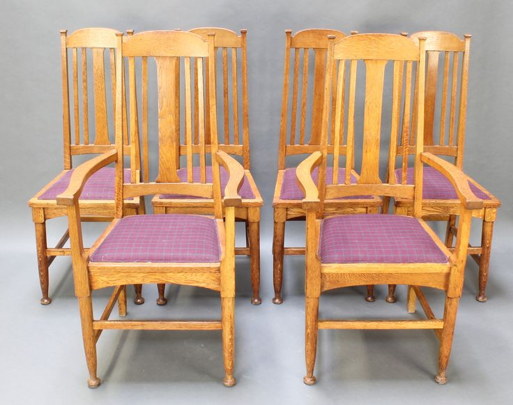 Lot 998, A set of 6 oak Art Nouveau Liberty style stick and rail back dining chairs, the seats raised on turned supports with box framed stretcher est £250-350