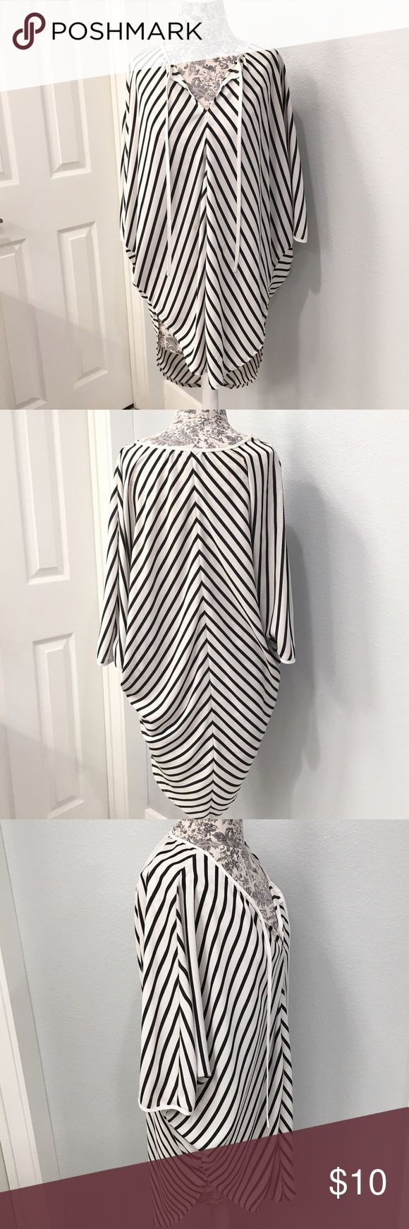 Swimsuit Cover up / Tunic / Dress This top is incredibly versatile. I am a size 6 / small but I  purchased this as a large from the maternity section. It has a perfect flow to it. I have worn it as a swim suit cover up as well as just a dress. Modern black and white stripes make it look so fancy! Mossimo Supply Co Dresses High Low