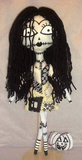 This of course is an homage voodoo doll of Sally from the Tim Burton film 'The Nightmare before Christmas.' She really is an example of been sewn together, her body and her clothes all with exposed stitching which of course I have to include some in my costume.