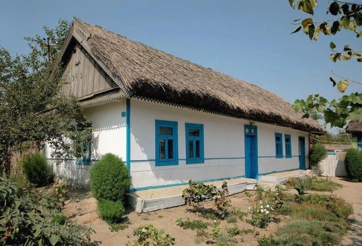 House in Danube Delta, Dobrogea. Roofs are made of local reed, and colors are light, like Mediterranean houses.