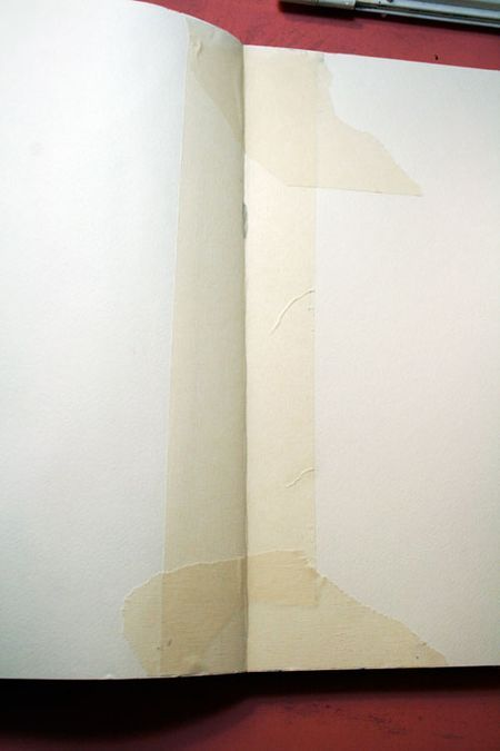 Prep every art journal page with masking tape down the center seam (to prevent paint from seeping between pages) and a coat of gesso, per Balzer Designs blog. [Good tip!]