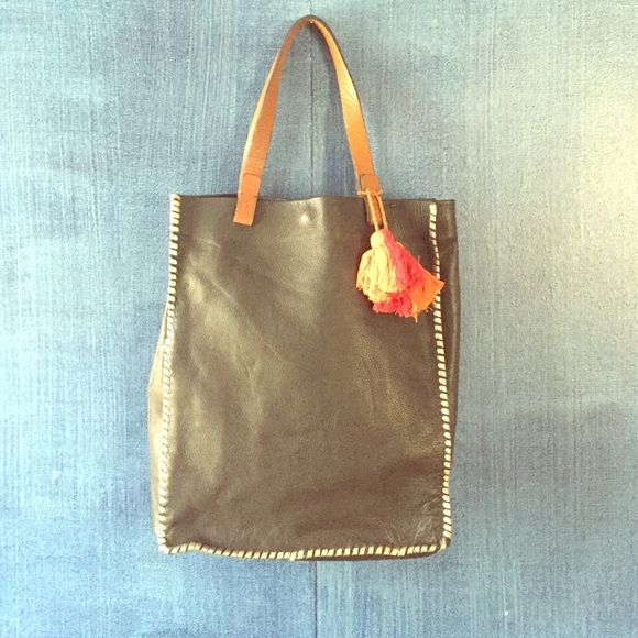 "Lucky Brand Black Leather Tote This is a beautiful brand new lucky bag brand new with tote. The tag is gone but it's brand new. It is 16"" high 13"" wide 6"" deep. Lucky Brand Bags Totes"