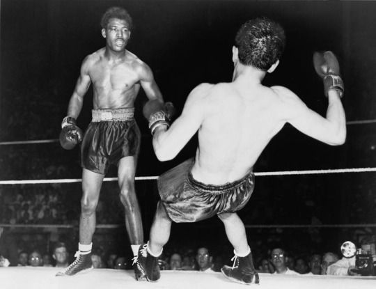 """Jimmy Doyle falls to the mat after being knocked out by """"Sugar"""" Ray Robinson. Doyle would die in a hospital a few hours later. June, 1947"""