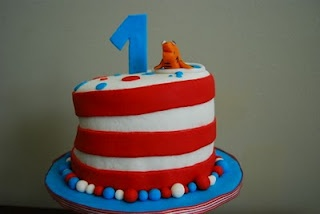 Dr. Seuss 1st Birthday Cake Idea- could use frosting with strips of red fondant?