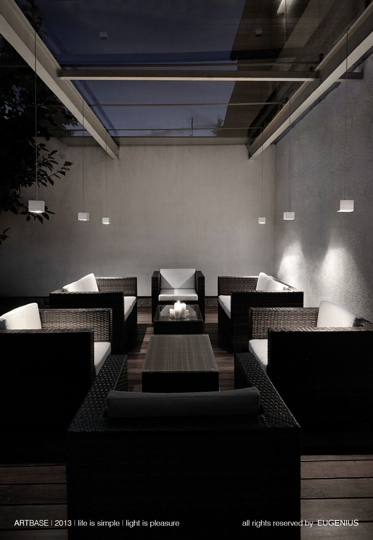 EUGENIUS. modern lighting, interior lamps for home, modern light. white cubes, hanging lamps, above stylish seats made from rattan, glass roof and wooden tables. perfect for evening in the terrace.