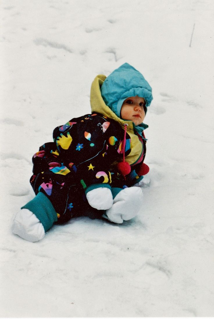 #Reima70 Snow on the ground in 1996, sitting in the snow is my daughter, glad in ever-so-lovely winter uniform. Bought at a flea market, the outfit is still there, waiting for the next generation :) -Kikka