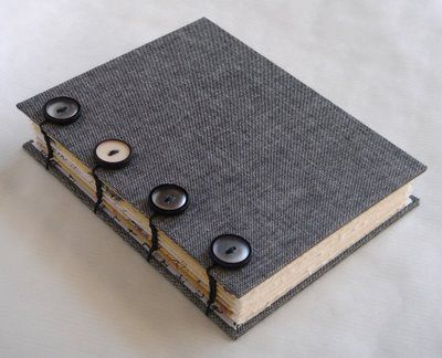 "Button Coptic by Lori Vliegen. ""I've managed to add buttons to some of my other books, and since I've discovered the coptic binding, i decided to merge the two...and here's the result. I'm really happy with the combination of the tweed looking bookcloth and the vintage buttons."""