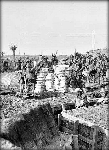 WWI, 18 Feb 1918; Troops of the Royal Engineers constructing reserve trenches and strong point at Wieltje. The men in background are making concrete slats. (Detail) © IWM (Q 10265)