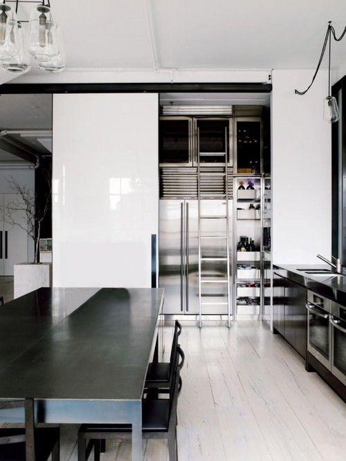 modern stainless steel + white kitchen, wine shelving