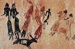 """The dancers of Cogul. (Detail) Nine women are depicted. Some are painted in black and others in red. They were seen dancing around a young male figure with abnormally large phallus. Along with humans, there are several animals. - Ausdruck der Ergriffenheit der Frühmenschen. Der Tanz galt der Großen Muttergöttin (Erich Neumann: """"Die Große Mutter"""")."""