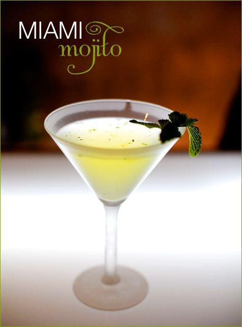 Miami Mojito Martini      (3 oz Light Rum  2 oz Lime Juice  1/2 tsp Sugar  Mint Leaves)