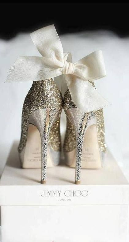 Glittery Jimmy Choo heels There is no way you can go wrong with glitter and satin on heels :)