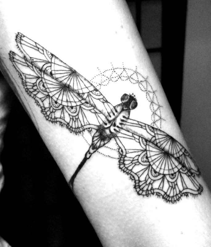 Not sure why dragonflies are so popular as a tattoo, but this is pretty.