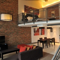 Our loft rooms offer you double volume comfort and the luxury of space with sleek and sophisticated design that has become synonymous with loft living. A downstairs lounge, GUEST bathroom and kitchenette, complete with microwave oven, bar fridge and Nespresso espresso maker means your absolute comfort is guaranteed.