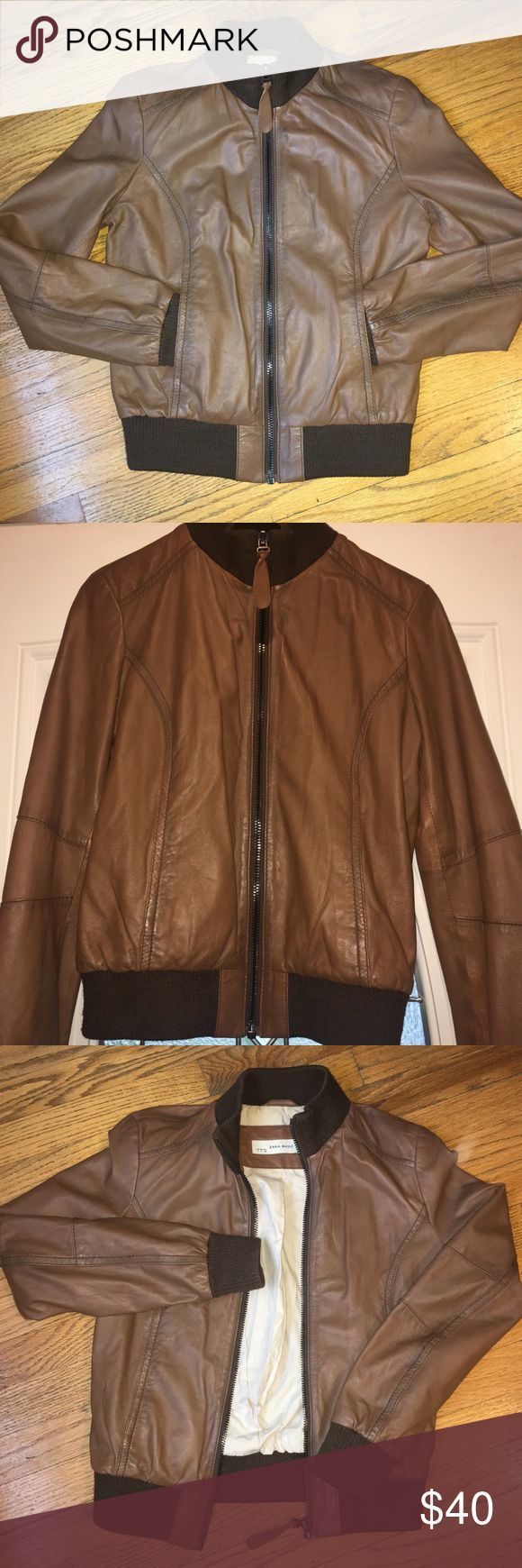 Zara Brown Bomber Jacket - Sz Medium GUC this jacket has no visible flaws only normal pre-owned wear. The lining is clean and in really good shape. These is a small amount of piling around the bottom of the jacket and the insides of the sleeve. I'm not a leather expert but I believe that this jacket is faux leather but I'm not certain. Please consider before purchasing item. Zara Jackets & Coats