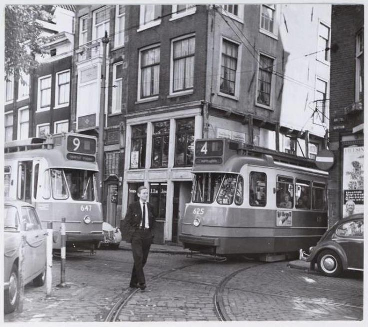 1960's. Tramlijn 4 exiting the Bakkerstraat, a small street that connects the Rembrandtplein and Amstel, in Amsterdam. Photo © Amsterdam Rail. #amsterdam #1960 #Bakkerstraat