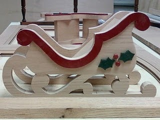Great way to give a bottle of wine as a Christmas gift.....in a wine sleigh.