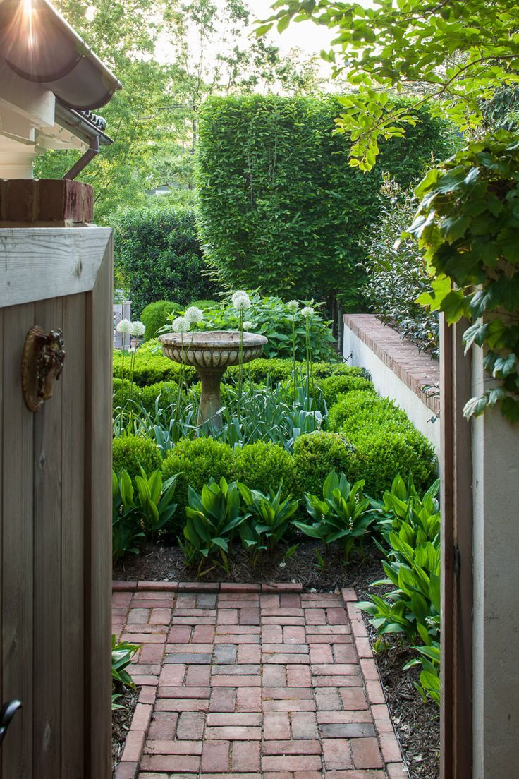Love the birdbath and boxwoods. Perfect neat hedges!