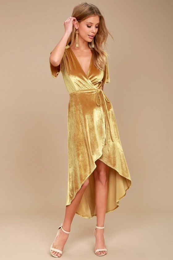 Lulus Exclusive! Love is in the air whenever the Amour Golden Yellow Velvet High-Low Wrap Dress enters the room! Luxe stretch velvet drapes elegantly across a wrap bodice with short sleeves, plunging neckline, and slender straps that tie at the waist. High-low skirt ends at a rounded hem.