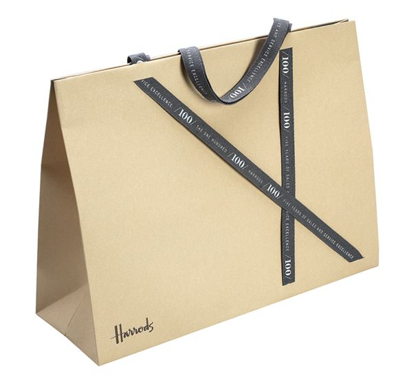 Harrods Carrier Bag - The paper was custom dyed and foil debossed. The bag was then die cut across the face and custom dyed and screen printed ribbon inserted http://progresspackaging.co.uk