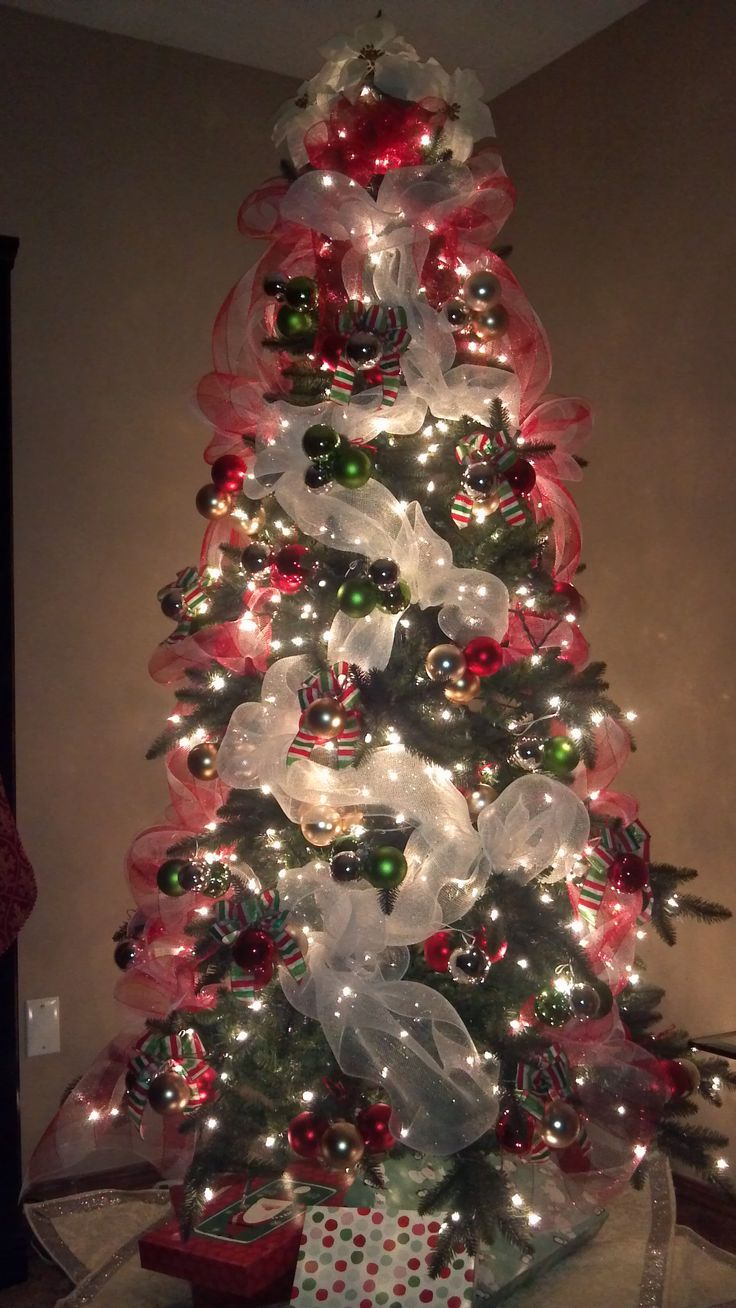 A deco mesh Christmas Tree with lights