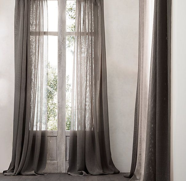 Restoration Hardware open weave sheer linen drapery welcomes light while offering rich textural interest.