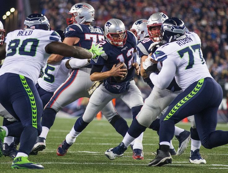 Seahawks vs. Patriots:  31-24, Seahawks  -  November 10, 2016  -    Seahawks vs. Patriots:  31-24, Seahawks  -  November 10, 2016  -    New England Patriots quarterback Tom Brady (12) get corralled and sacked during the second half. (Mike Siegel / The Seattle Times)