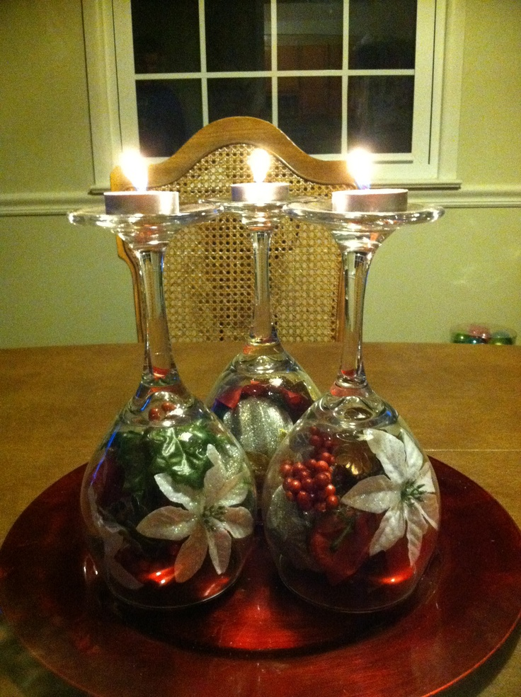 Wine glasses ornaments and tea light candles christmas