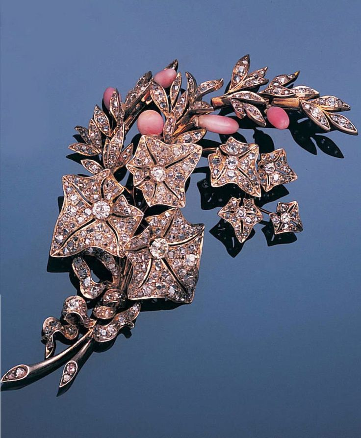 A late 19th century diamond and conch pearl spray brooch, circa 1880. Naturalistically modelled as a spray of pierced ivy leaves amongst foliage set with old brilliant and rose-cut diamonds, with conch pearl bud detail, tied at the base with a cushion-shaped diamond fluttering ribbon, French assay marks, one conch pearl deficient, length 9.1cm., fitted case