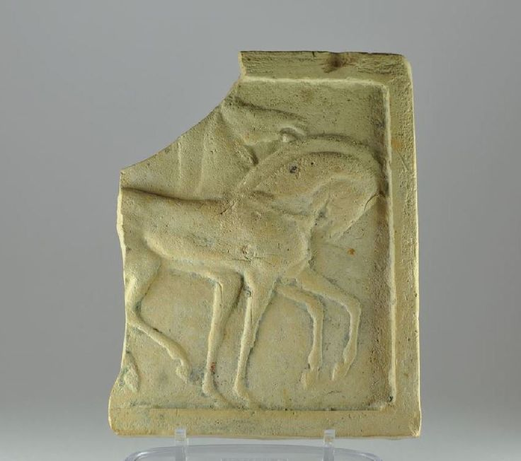 Greek relief with two horses, 5th century B.C. Greek archaic terracotta plaque with two horses, 14.7 cm high. Private collection