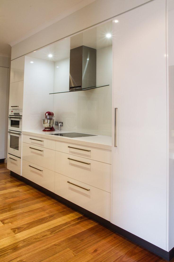 Modern kitchen. Galley style kitchen. Exposed rangehood. Induction cooktop. www.thekitchendesigncentre.com.au