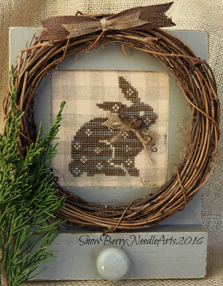 Primitive cross stitched bunny in old world charm desk frame.