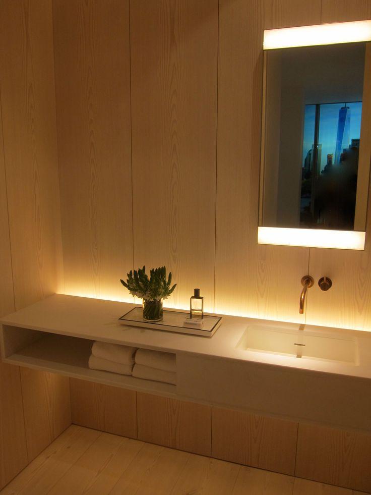 Guest bath: warm tones, subtle lighting.