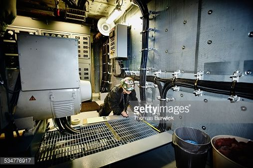 Stock Photo : Female engineer taking measurements of metal grate