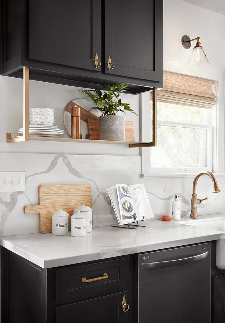 Black cabinetry really grounded this kitchen, while the quartz countertops, backsplash, and gold hardware really helped balance out the overall look of the kitchen.