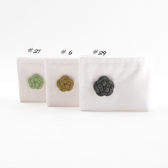 Unique designed and perfectly finished flower cuff links. Made of cotton twine with metal cuff link bases. Available in 3 shades and 2 sizes.   Limited edition order before they are gone.
