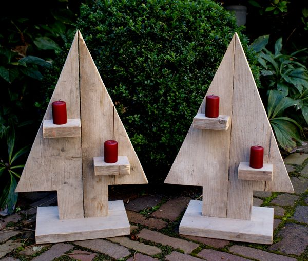 Little wooden christmas trees with candles