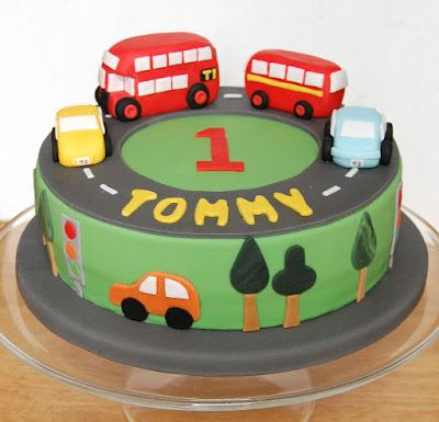 Eli 2nd birthday cake - Bus Birthday Cake topped with multiple toy buses