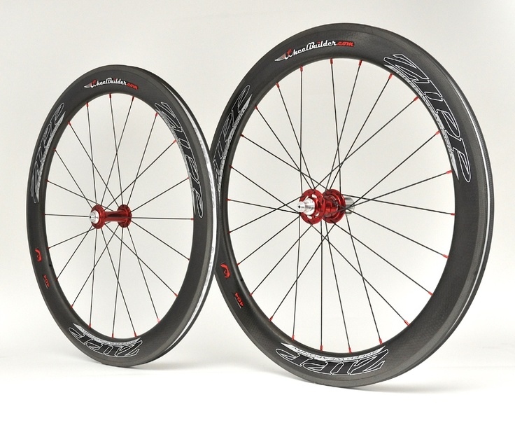 Precision handcrafted Zipp 404 Firecrest carbon clincher rims with red Chris King R45 hubs, black DT Swiss aerolite bladed spokes, and red Wheelbuilder.com high-strength alloy nipples. 1515g.