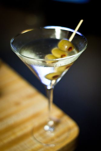 Classic Martini: 2 1/2 oz Junipero gin 1/2 oz dry vermouth 1 green olive or lemon twist, for garnish