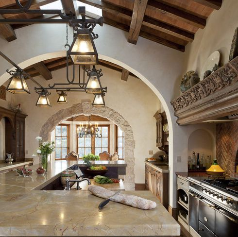 Custom Iron Pendant Lights and Chandelier in a Mediterranean Style Kitchen