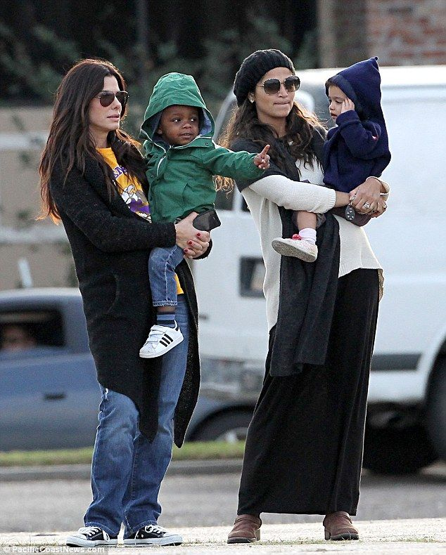 Sandra Bullock and Camilla Alves hanging out with their kids.