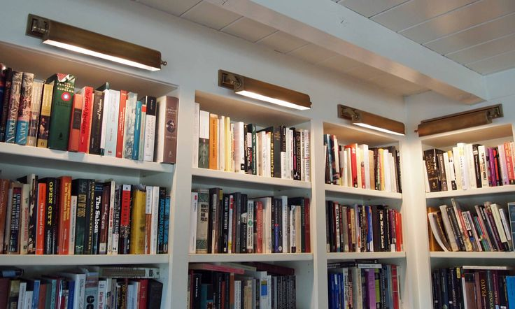 Love The Library Lights Over The Bookcases The Lights Give The Room A Warm Welcoming Glow As