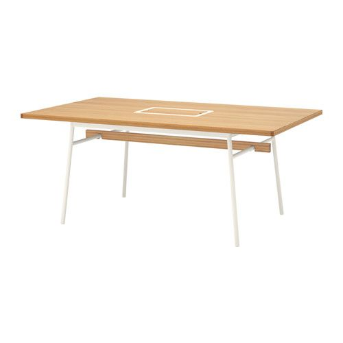 This table is so cool. It has this perfect little storage thing in the center.... I want something like this... or this
