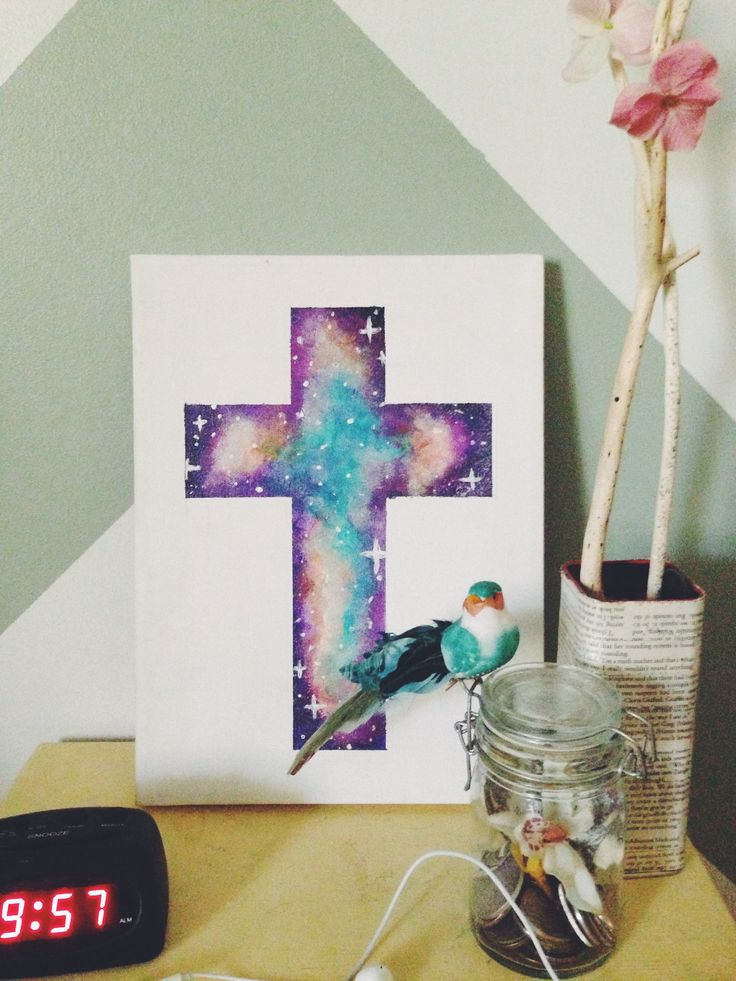 DIY galaxy cross on canvas board. You can find tutorials on Youtube on how to paint a galaxy cross.