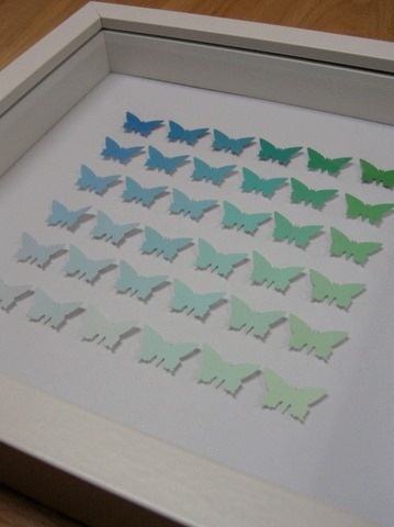 cool art piece made from paint swatches And a paper punch. So easy and cute.