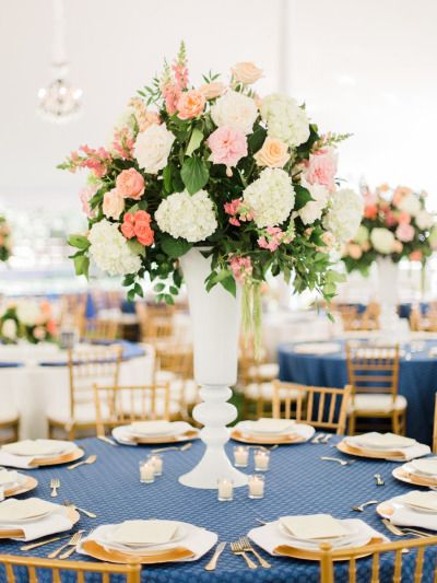Gorgeous tall centerpieces: http://www.stylemepretty.com/colorado-weddings/denver/2015/01/08/elegant-backyard-summer-wedding/ | Photography: Rachel Havel - http://rachelhavel.com/